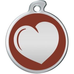 Billede af rundt hundetegn med hjerte på brun baggrund.