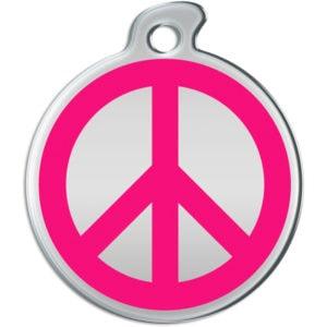 Billede af rundt hundetegn med pink fredstegn på sølvfarvet baggrund