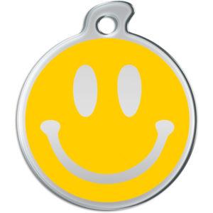 Billede af rundt hundetegn med smiley på gul baggrund.
