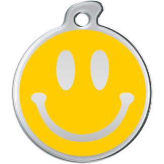 Dog tag decorated with a smiley on yellow background.